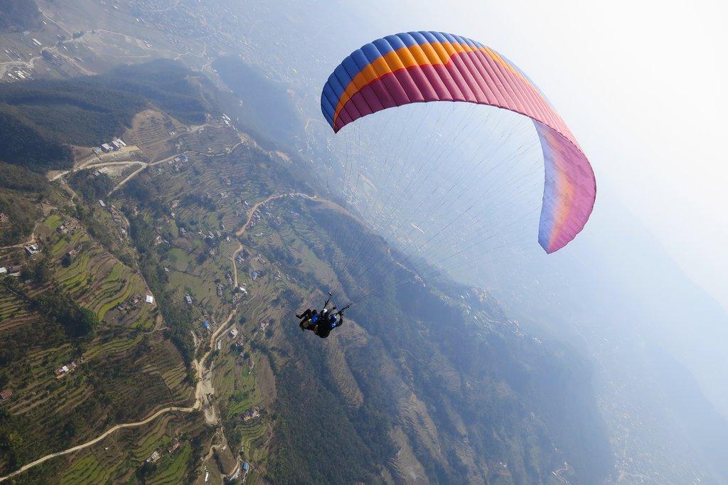 Tandem paragliding above Pokhara
