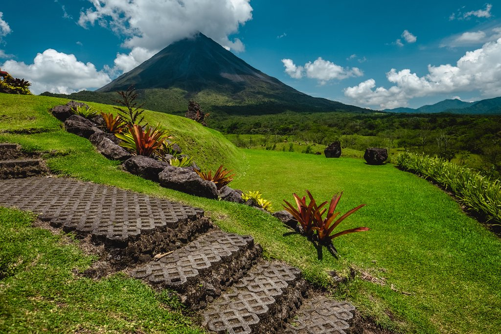 The majestic Arenal Volcano on a sunny day.