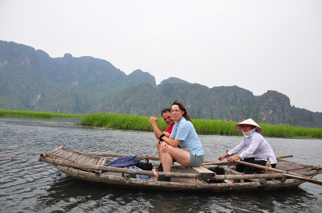 Riding a bamboo boat