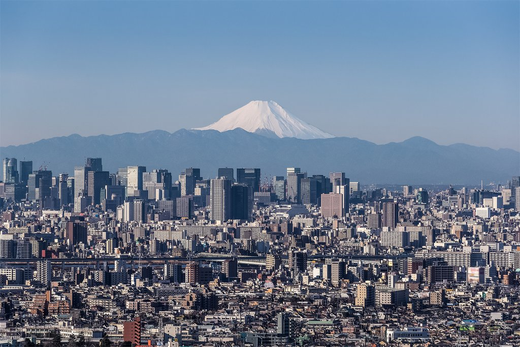 On a clear day, the impressive Mt. Fuji towers behind the Tokyo skyline