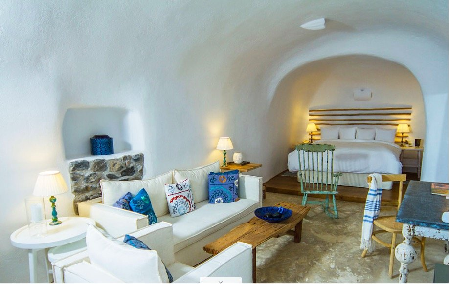 A curved guest room is shaped like the cave it was carved into (Photo courtesy of Iconic Santorini)