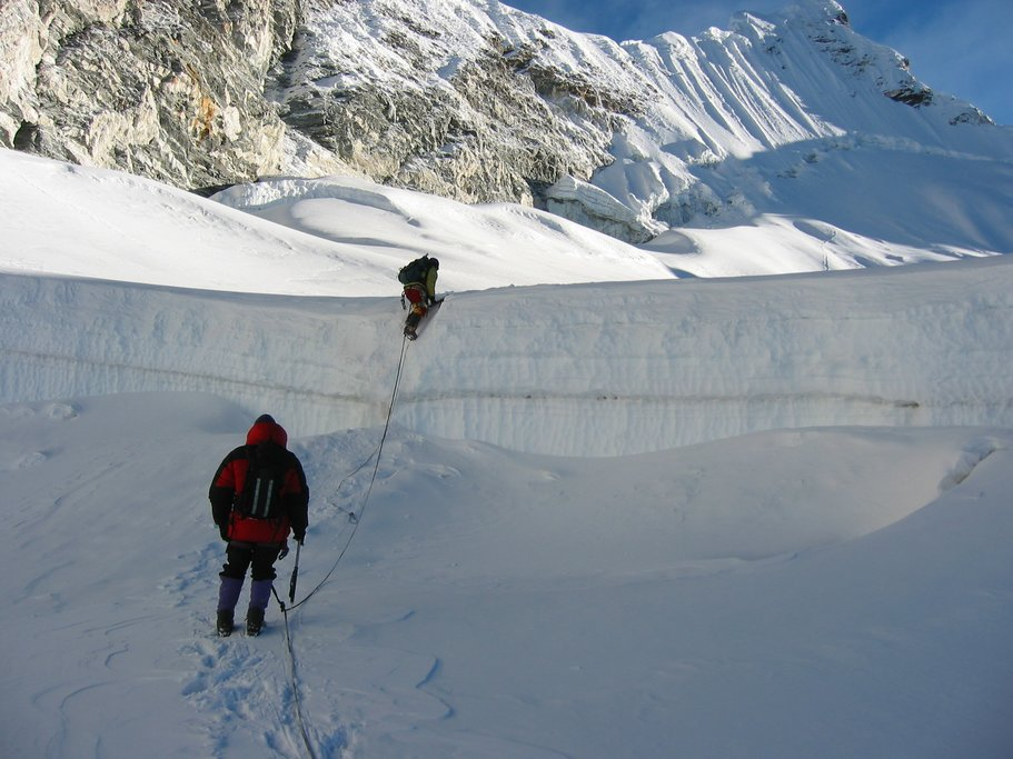 Crossing a large crevasse, Island Peak in the background