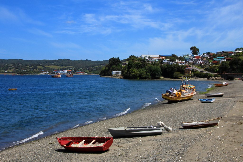 Fishing boats dot the seashore on Chiloé Island