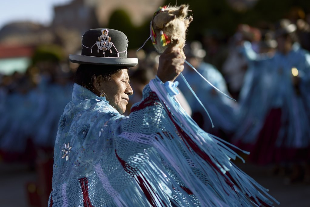 Aymara woman during the festival of the Virgen del Rosario, Chucuito