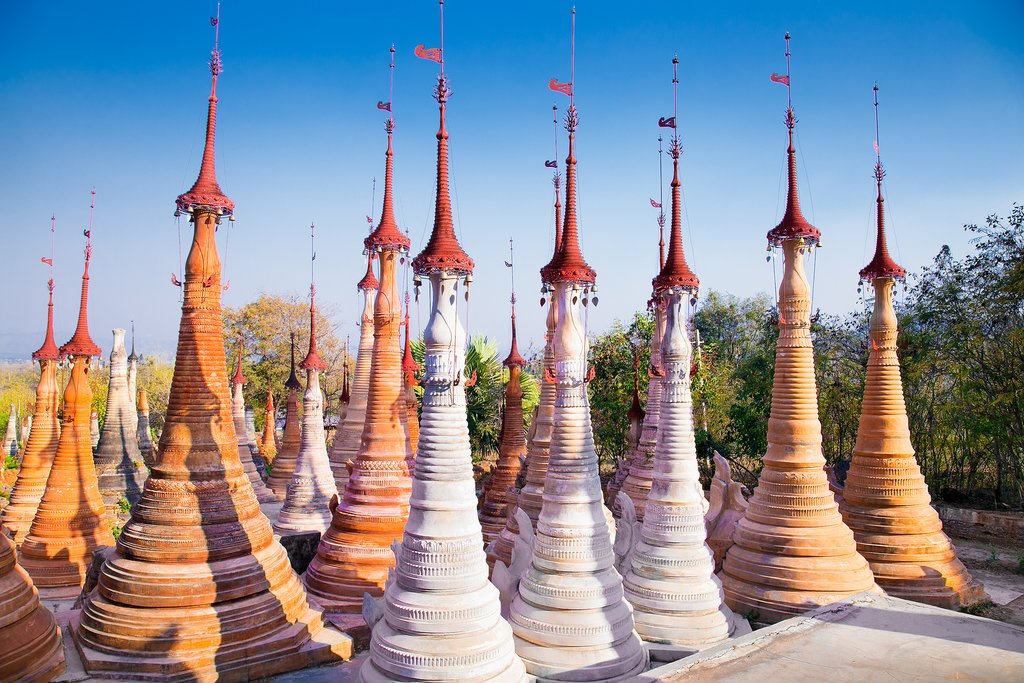 The local stupas and pagodas create a colorful contrast with the blue sky