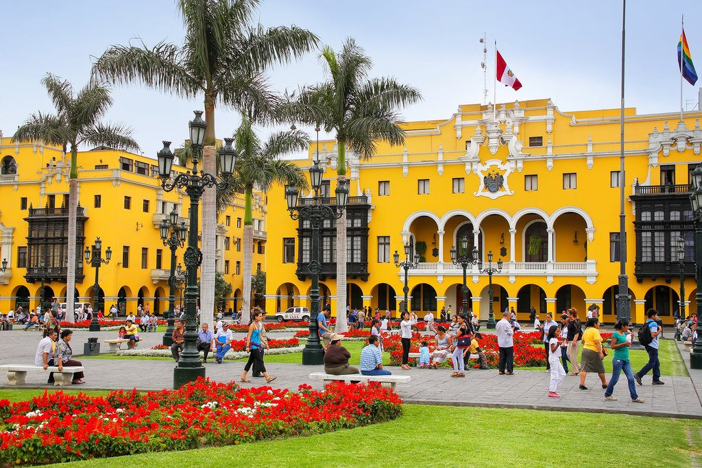 Pedestrians enjoy a leisurely day in Lima's Plaza Mayor.