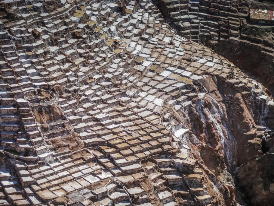 A view from above of Salineras, a patchwork of stone terraces used to harvest salt.