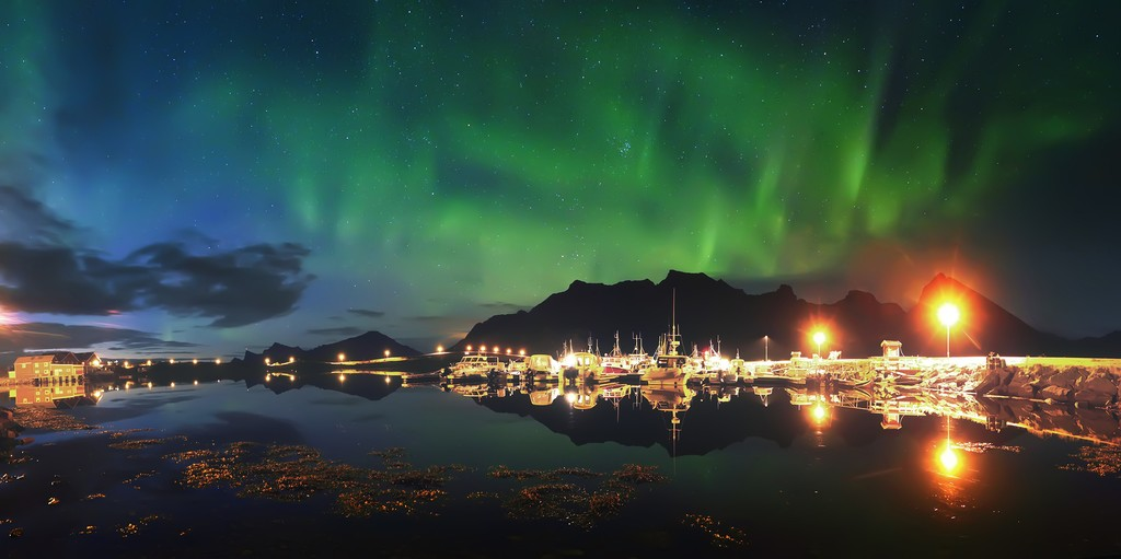 Northern lights over the fjord, Norway