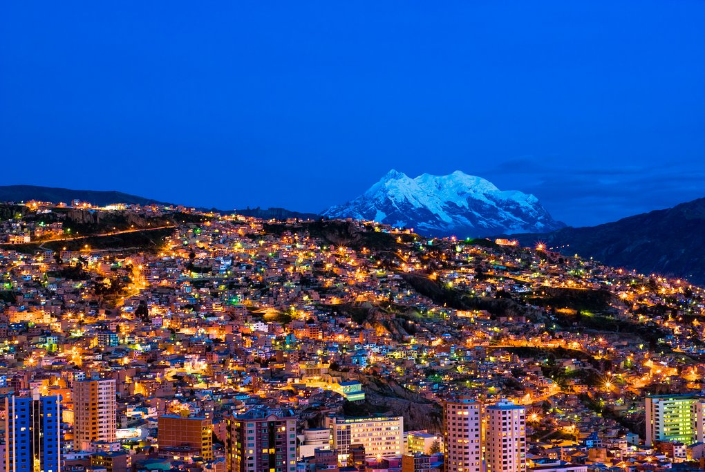 A panorama of the La Paz, Bolivia at night with the Andes mountains in the background