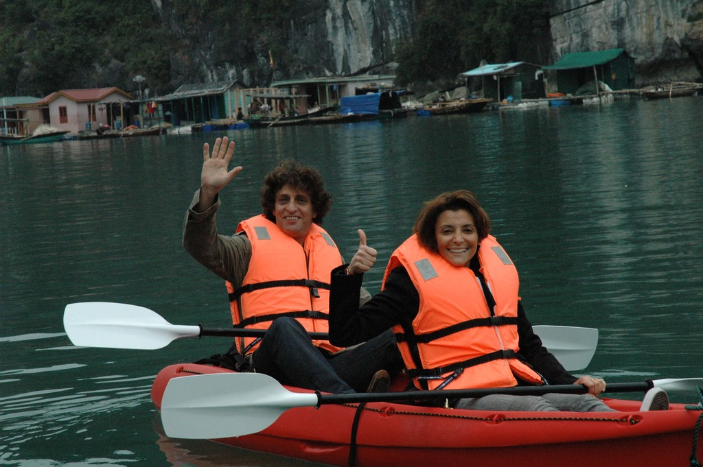 Travelers kayaking in the bay