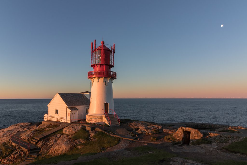 Bike past lighthouses and smooth rock formations.
