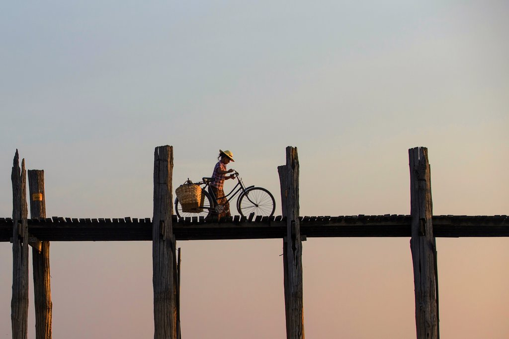 The U Bein Bridge spans nearly a mile and is the world's longest teakwood bridge