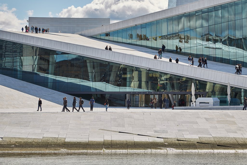 View of Oslo Opera House with people walking in front