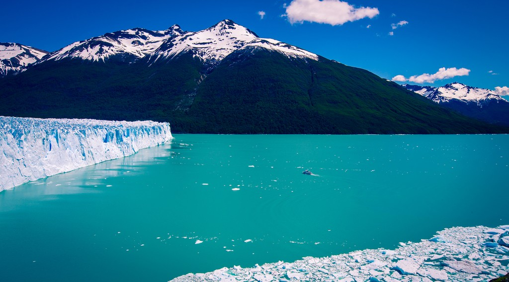 The glacial blue waters surrounding the Glacier reflect the sunlight and seem to glow from within