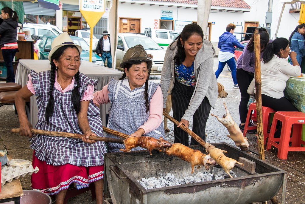 Food vendors prepare roasted cuy (guinea pig)
