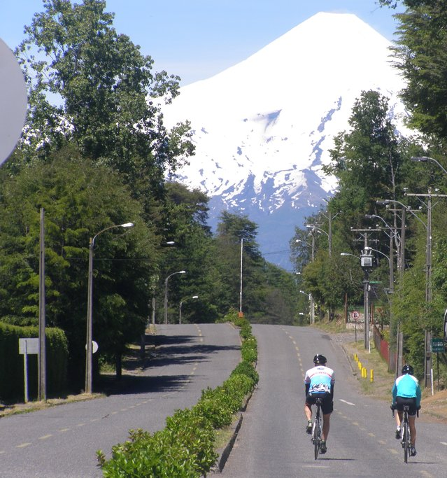Biking towards the spectacular Villarrica Volcano