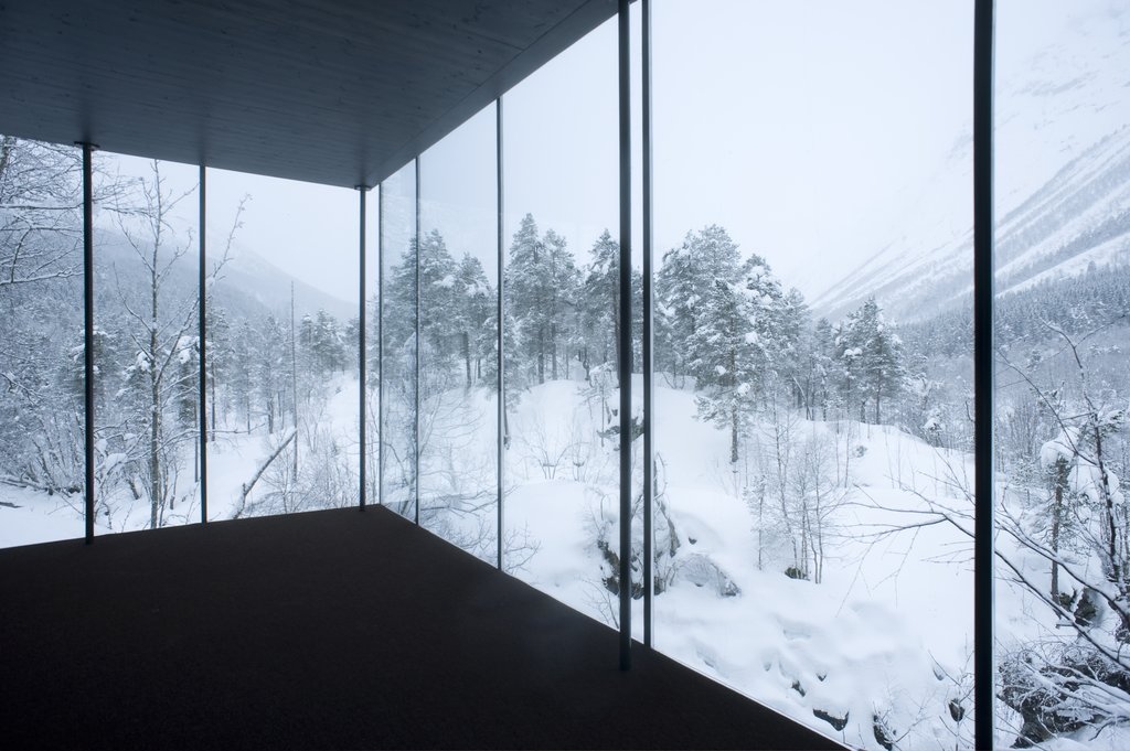 Snowy panorama through the windows of the Juvet Landscape Hotel