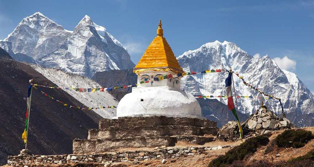 A Buddhist stupa in front of Mt. Thamserku