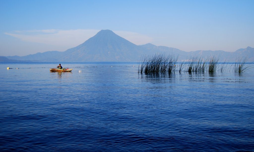 A boat on the azure waters of Lake Atitlan