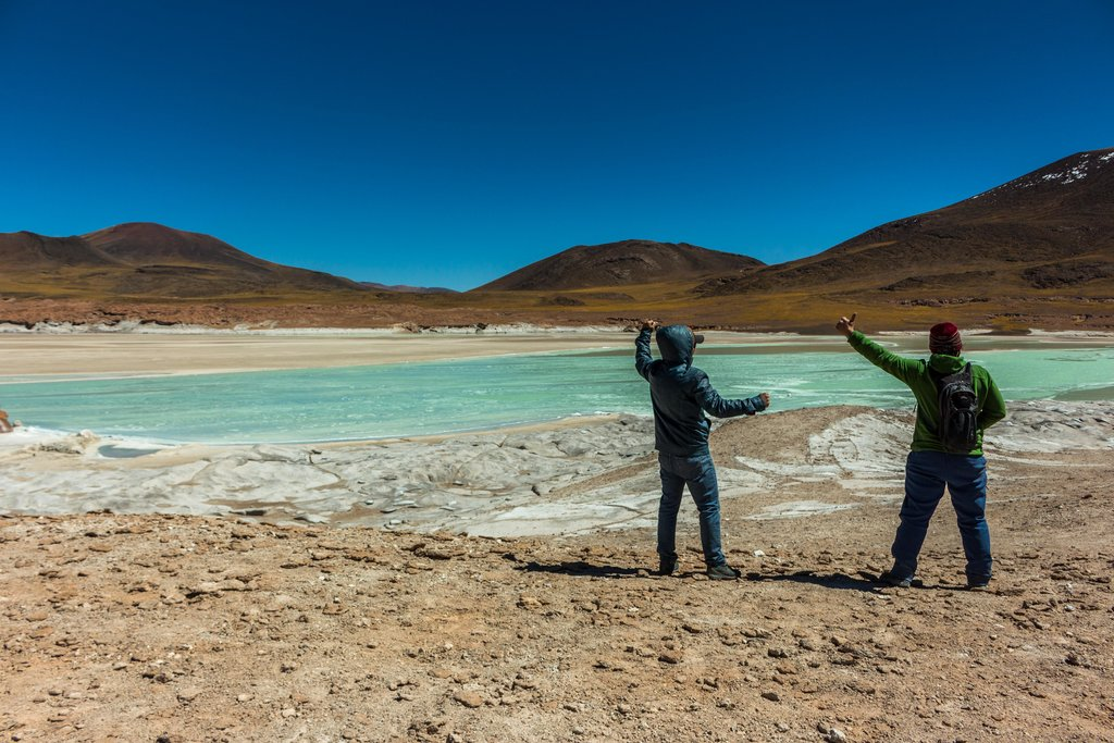 Feeling the Andean winds while taking in a high-altitude lake in the Salar de Atacama.