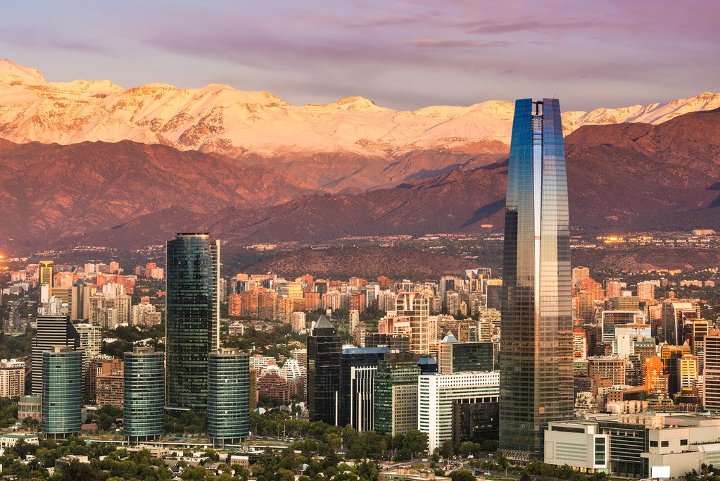The snow-capped mountains provide a stunning backdrop to this cosmopolitan city