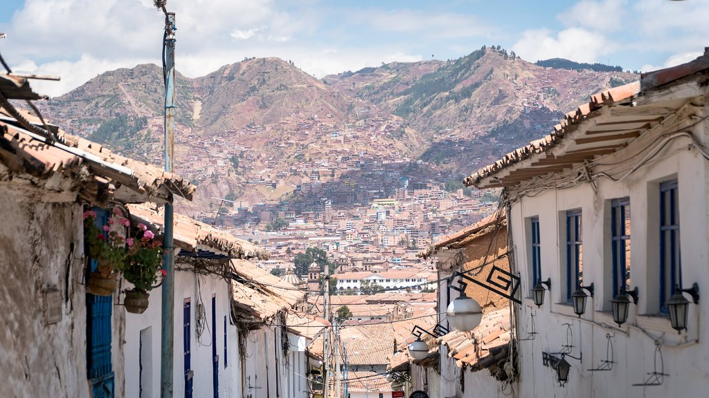 The narrow streets of Cusco with the Andes behind