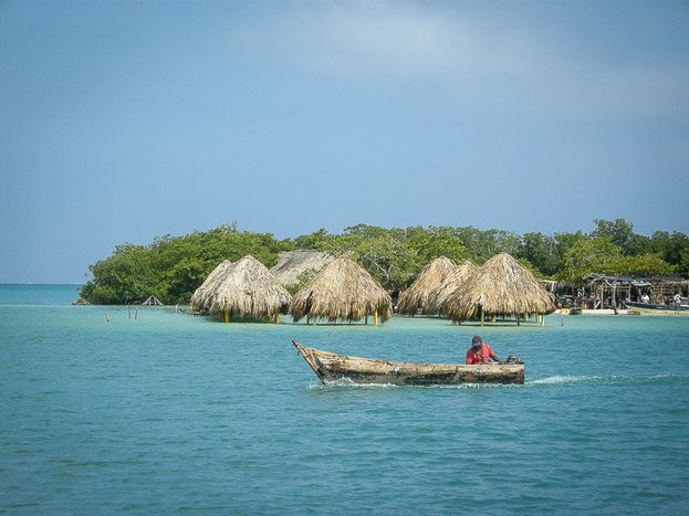Thatched huts located in the blue Caribbean waters are the perfect place to relax.