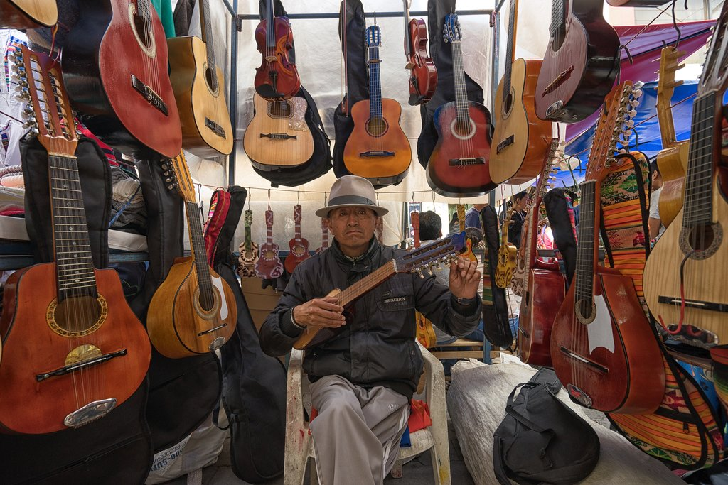 Musical instruments for sale in an Ecuadorian marketplace