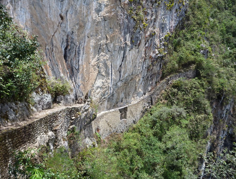 Walk on the stone walkway of the Inca Trail on the way to the ruins of Puerta del Sol