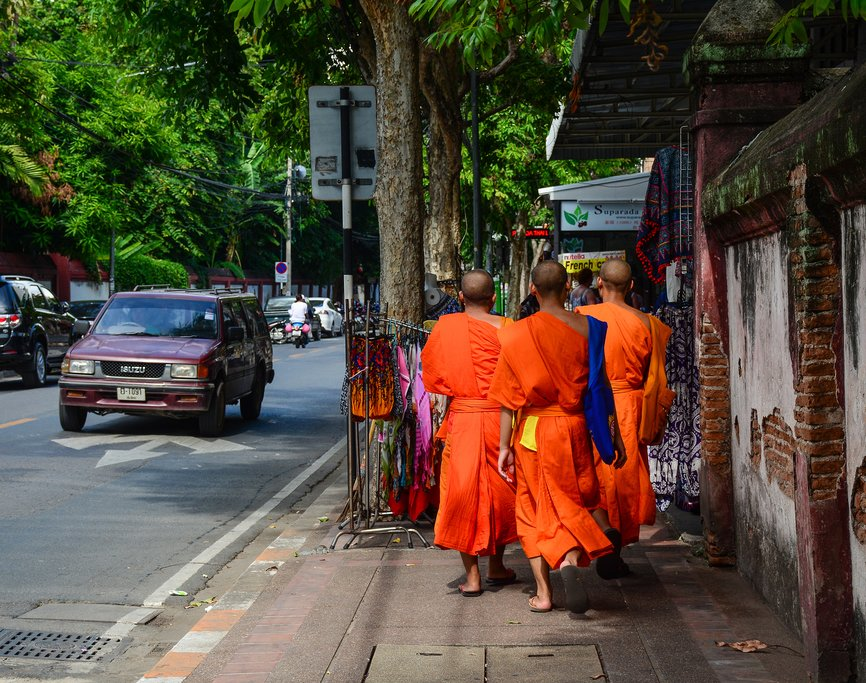 Monks walk along the streets of Chiang Mai