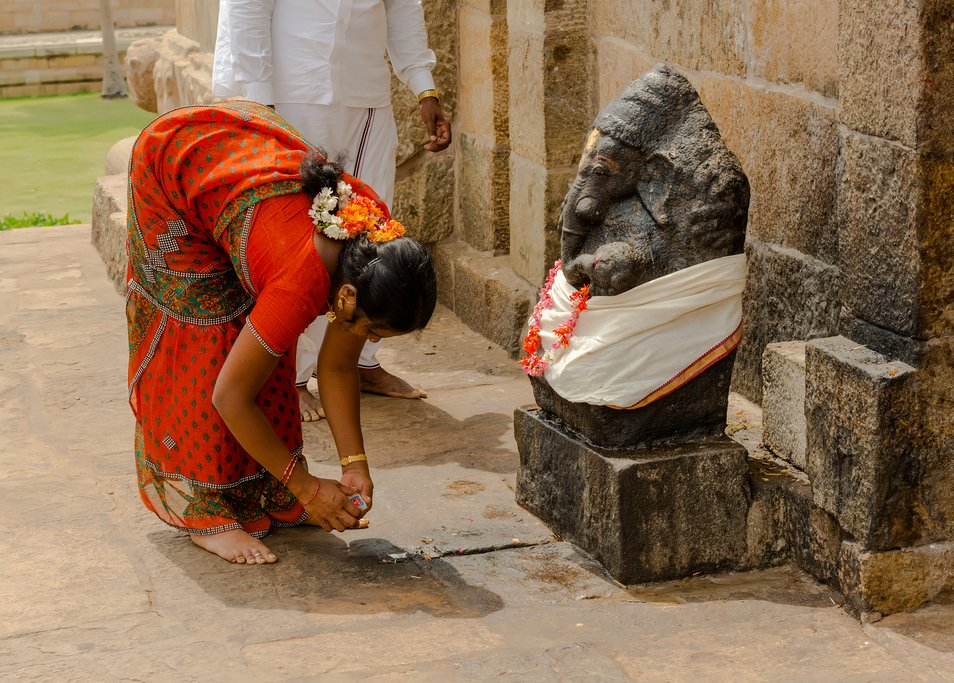 A woman worshipping a Ganesh statue at Tanjore