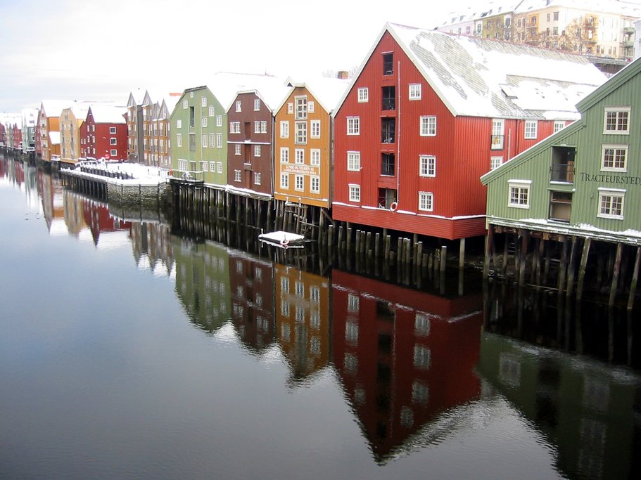 Check out the colorful wooden houses on the river.