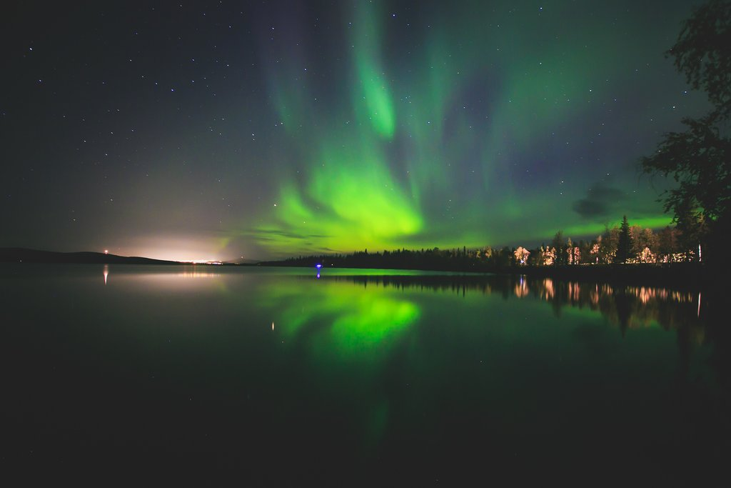 Northern lights over the water, Norway