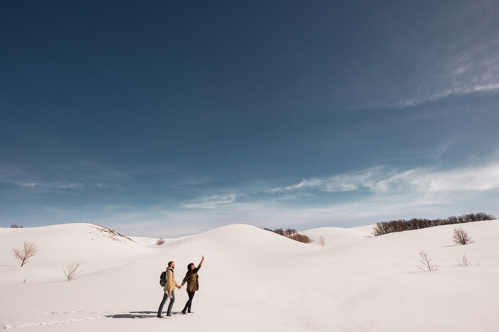 A couple explores a wintry landscape