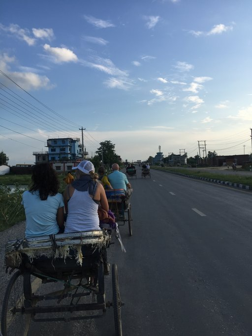 As the sun sets, take an electric rickshaw for a ride through the old village