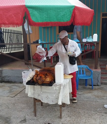 Suckling pig on sale in the street in Leticia