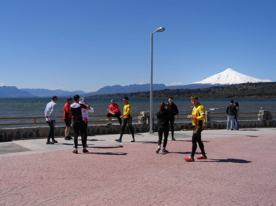 A group of bikers stops for photos on the waterfront of Pucón
