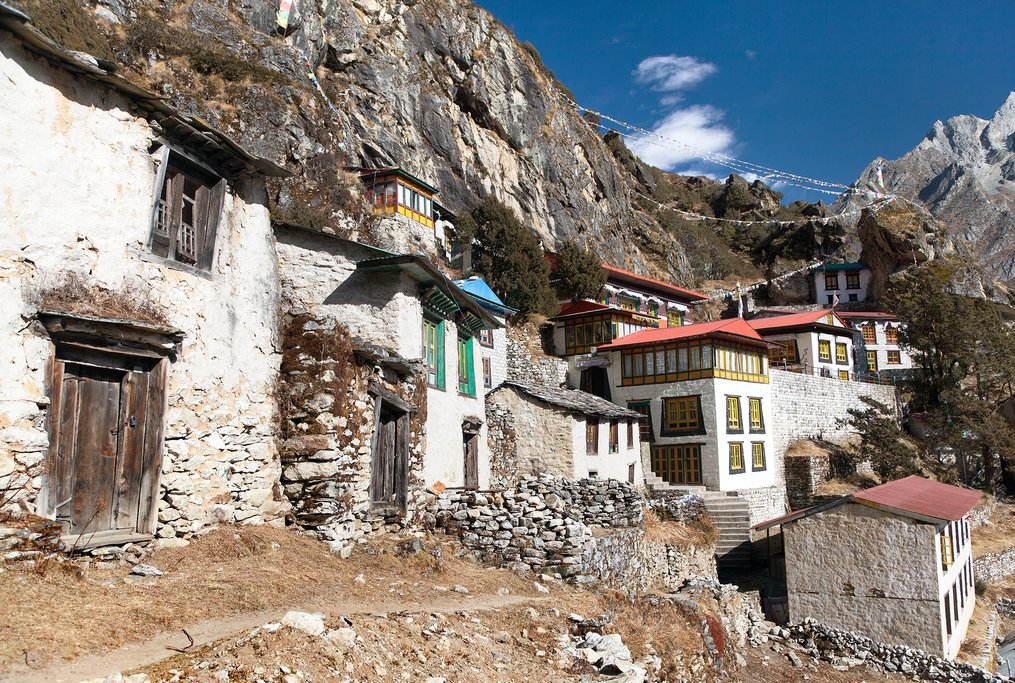 Thame gompa with prayer flags and buddhist symbols - monastery in Khumbu valley