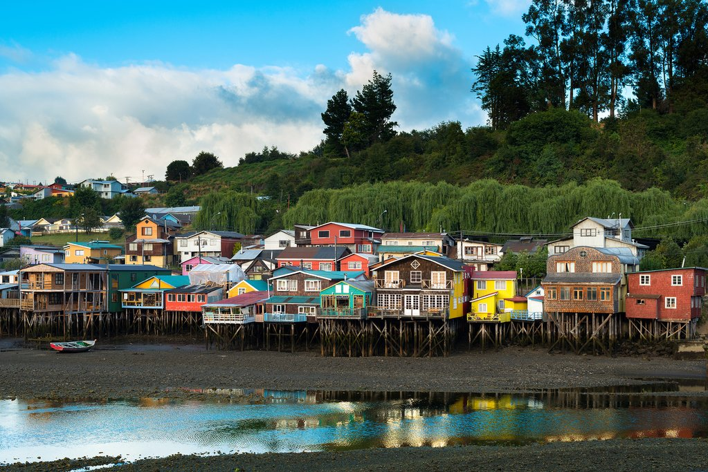 The colorful palafito houses line the waterfront of the Chiloé village of Castro