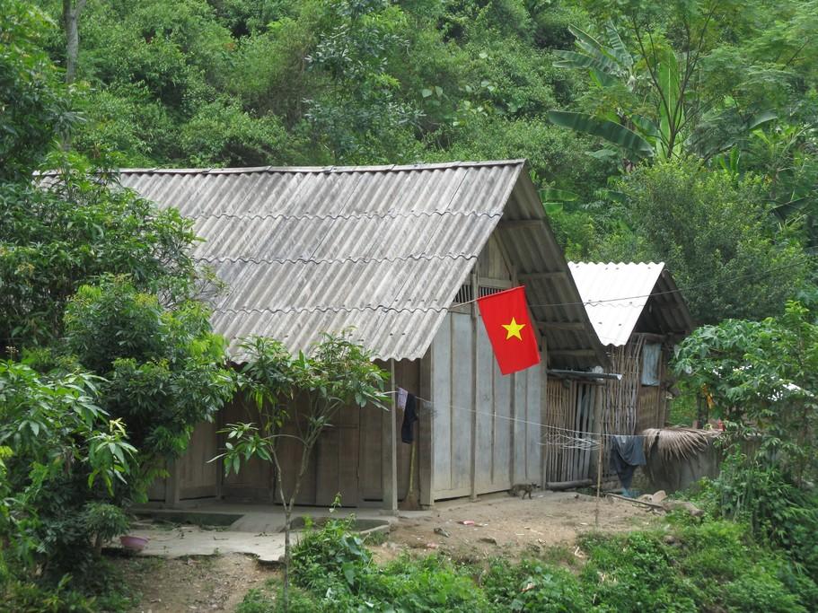 Rural Vietnamese homes flying the flag of Vietnam