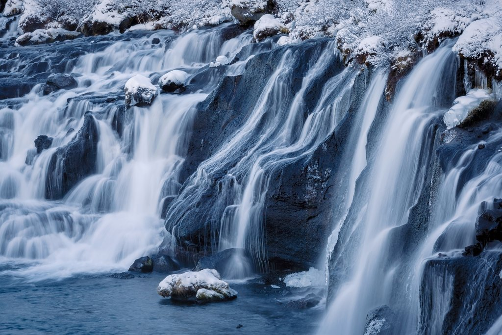 Frozen Hraunfossar falls in Winter