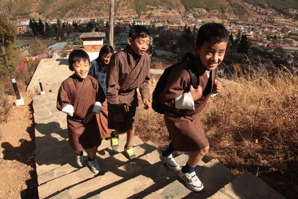 Children hiking above Thimpu