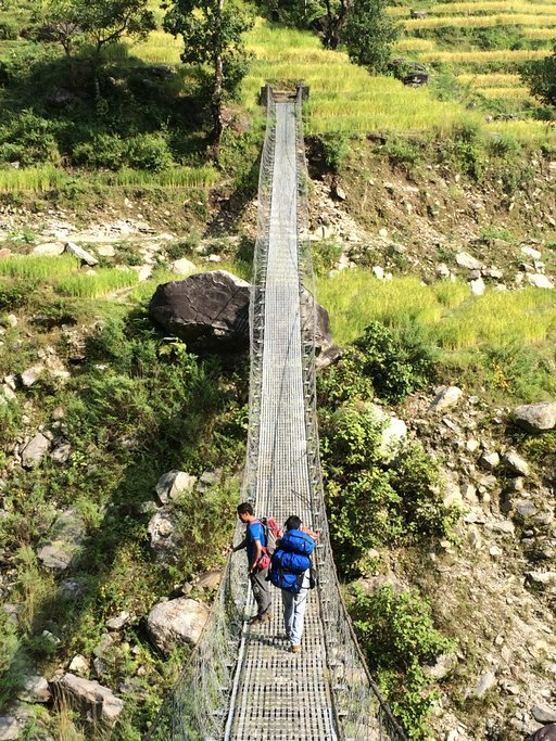 Crossing a suspension bridge on day 1 of the trek