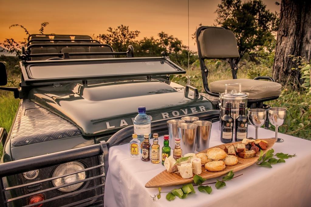 Enjoy a sundowner drink on safari
