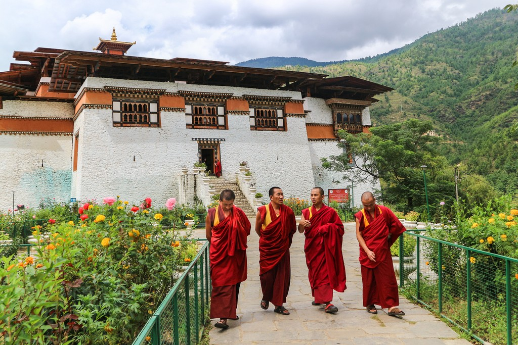 Monks in the garden at Simtokha Dzong in Thimphu