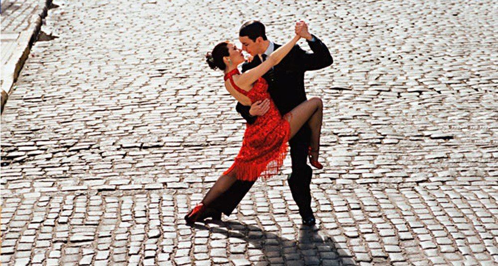 A couple dancing the tango in the streets of Buenos Aires.
