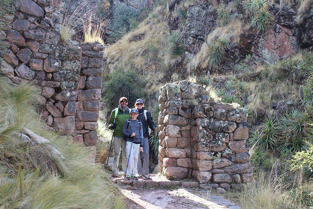 Family walking in Inca ruins
