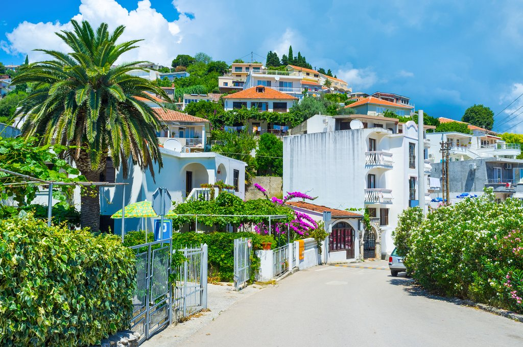 hilly street with tiny gardens surrounding the cottages and hotels Ulcinj Montenegro