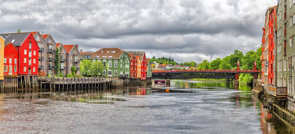 Panoramic view of Old Timber Buildings Old Town Bridge (Norwegian/ Gamle Bybro or Bybroa) over the river Nidelva in Trondheim. Trondheim historically Kaupangen Nidaros and Trondhjem Norway.