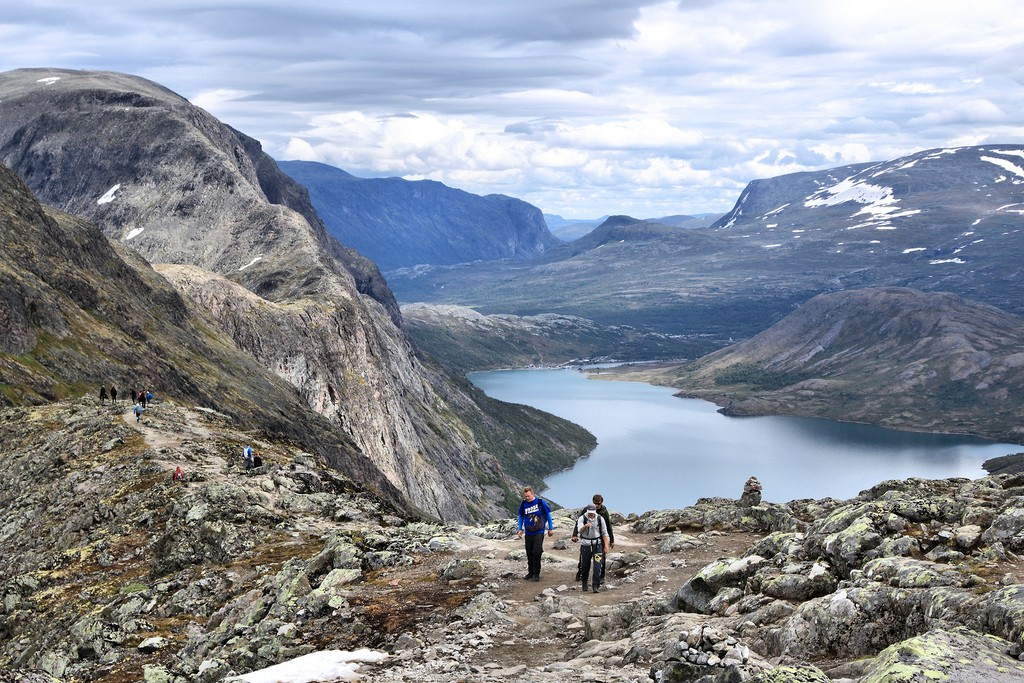 JOTUNHEIMEN NORWAY - AUGUST 1 2015/ People hike the Besseggen trail in Jotunheimen National Park Norway. Norway had almost 5 million foreign visitors in 2011.
